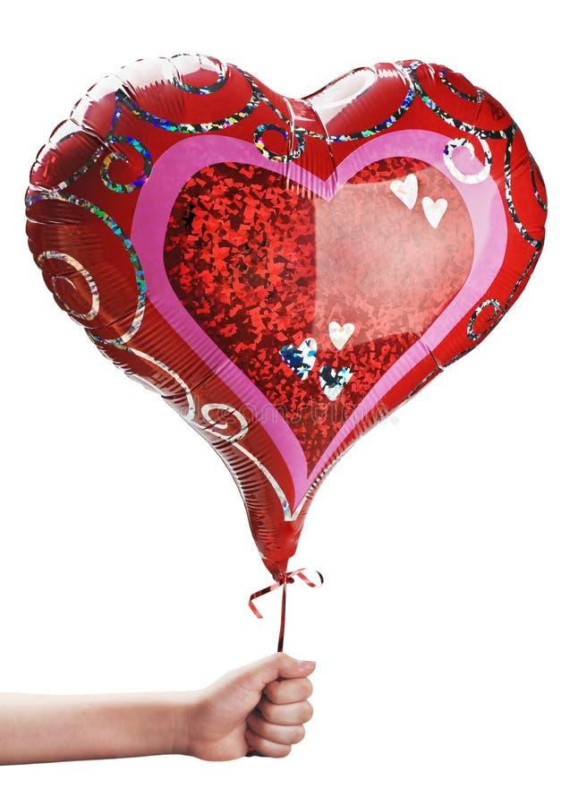 Красный воздушный шар в руке стоковая фотография rf