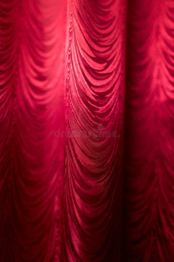 Красный занавес ткани как фон стоковое изображение