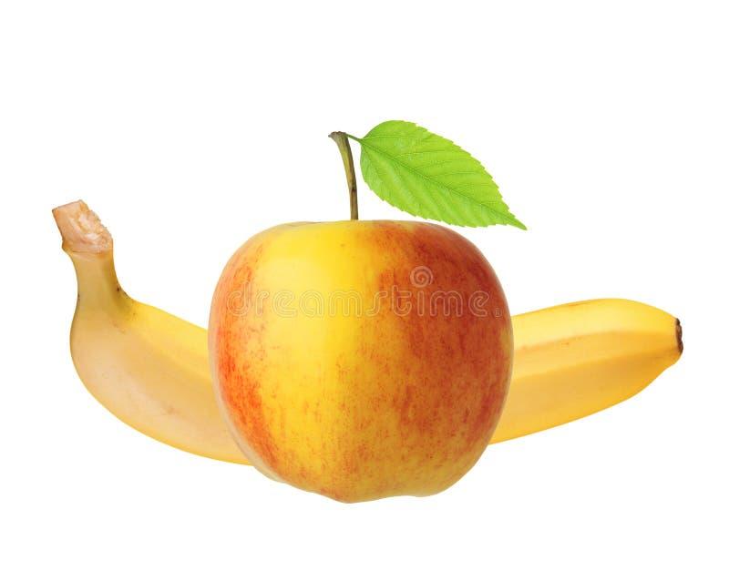 Красный и желтый плодоовощ яблока с зелеными лист и бананом изолировал o стоковые изображения rf
