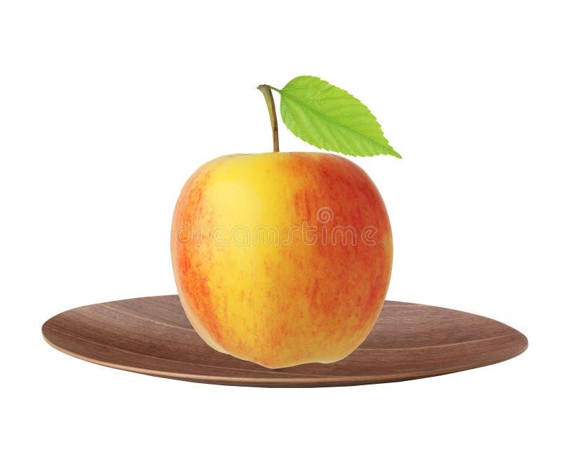 Красный и желтый плодоовощ яблока с зелеными лист на плите изолированной дальше стоковая фотография rf