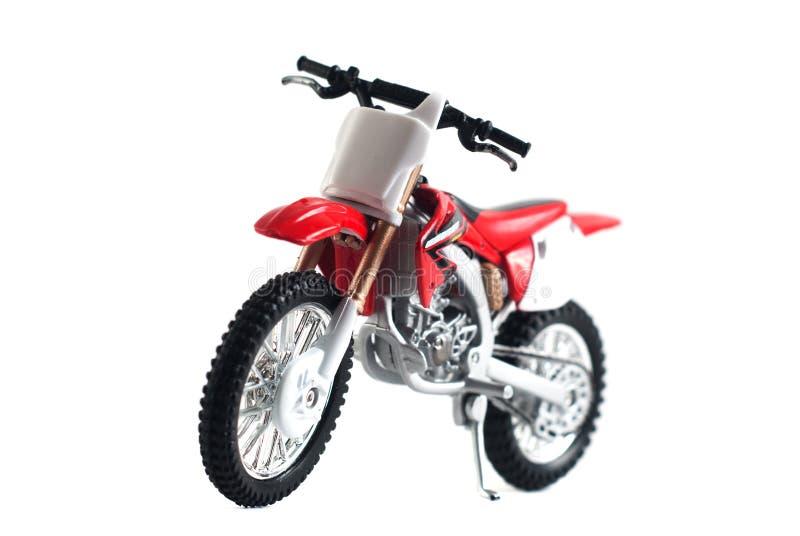 красный красный цвет игрушки мотоцикла изолированный на белой предпосылке, стоковое изображение rf