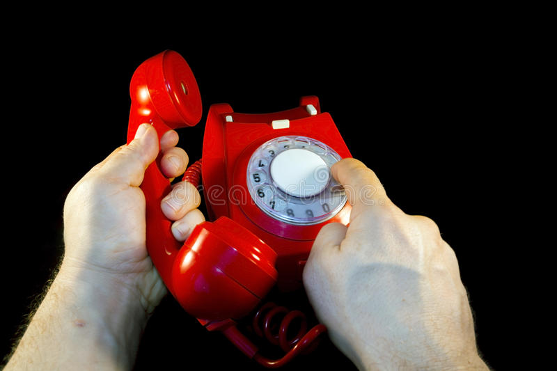 Красный набирать телефона стоковые фото