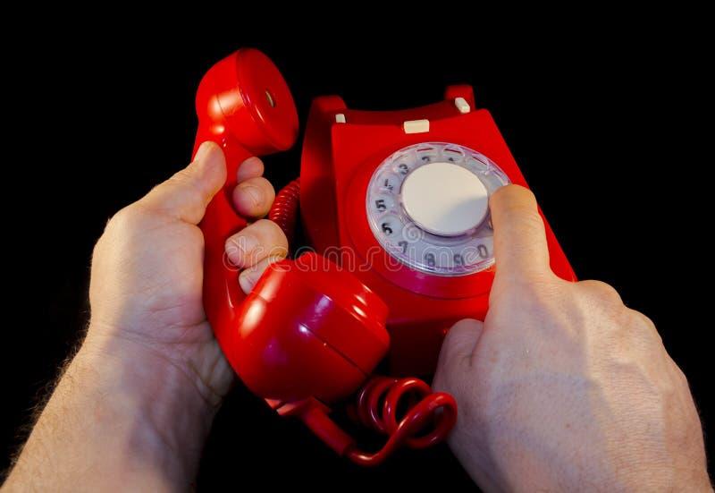 Красный набирать телефона стоковое фото