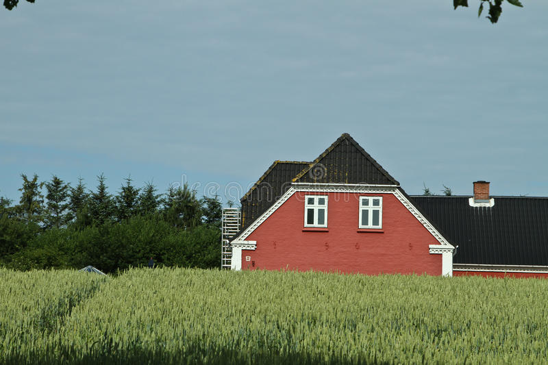 Красный дом в Denamrk стоковое изображение