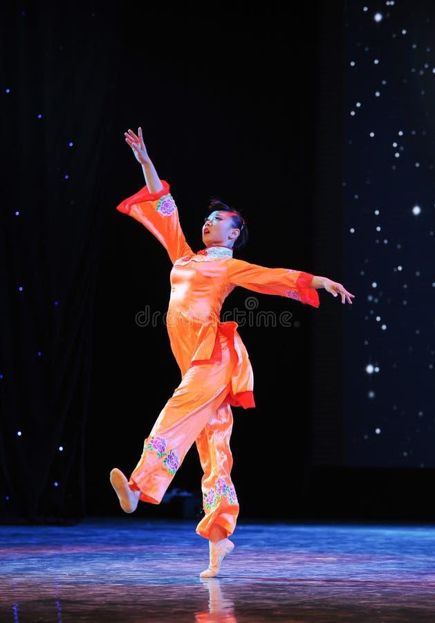 Красный оранжевый танец высоко-людей смертной казни через повешение стоковая фотография rf
