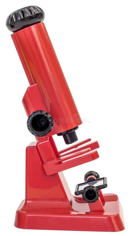 Красный пластичный микроскоп игрушки детей изолированный на белой предпосылке стоковая фотография