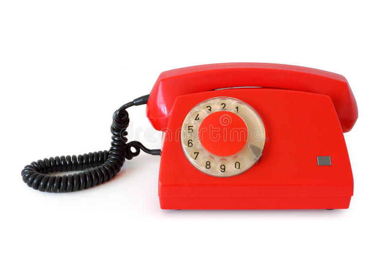 Красный ретро роторный телефон стоковая фотография