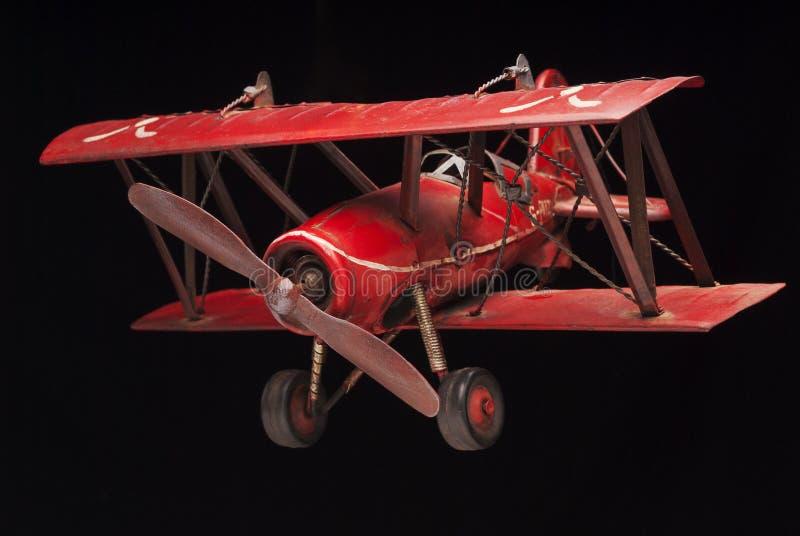 Красный самолет-биплан стоковое изображение