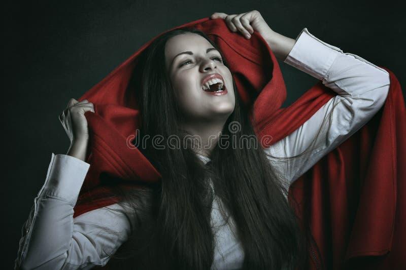 Красный с капюшоном вампир стоковое фото