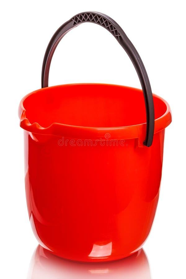 красный цвет ведра пластичный стоковая фотография