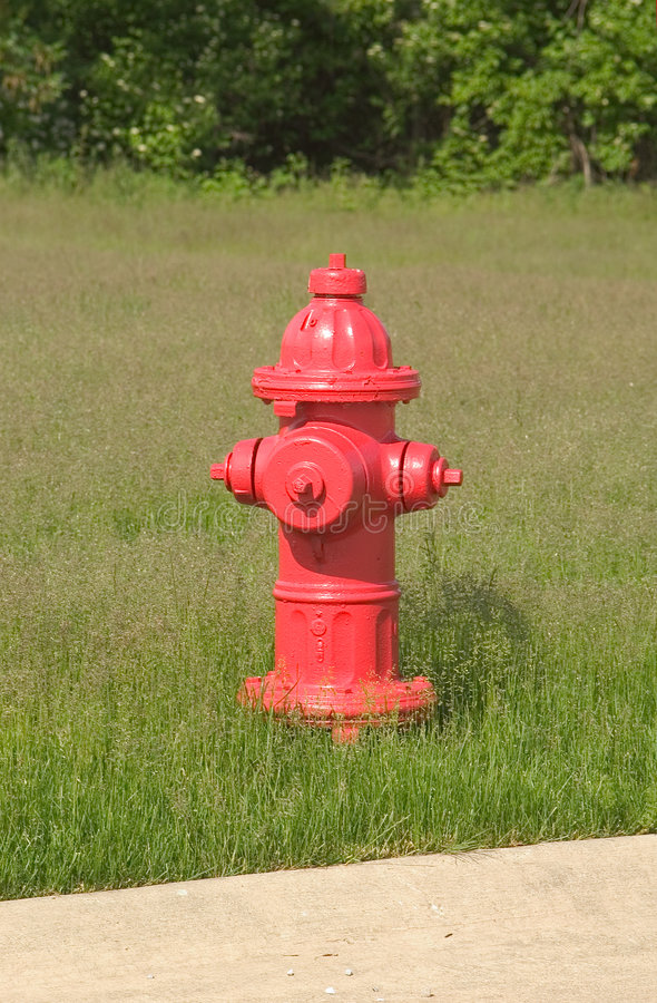 красный цвет гидранта Стоковые Изображения