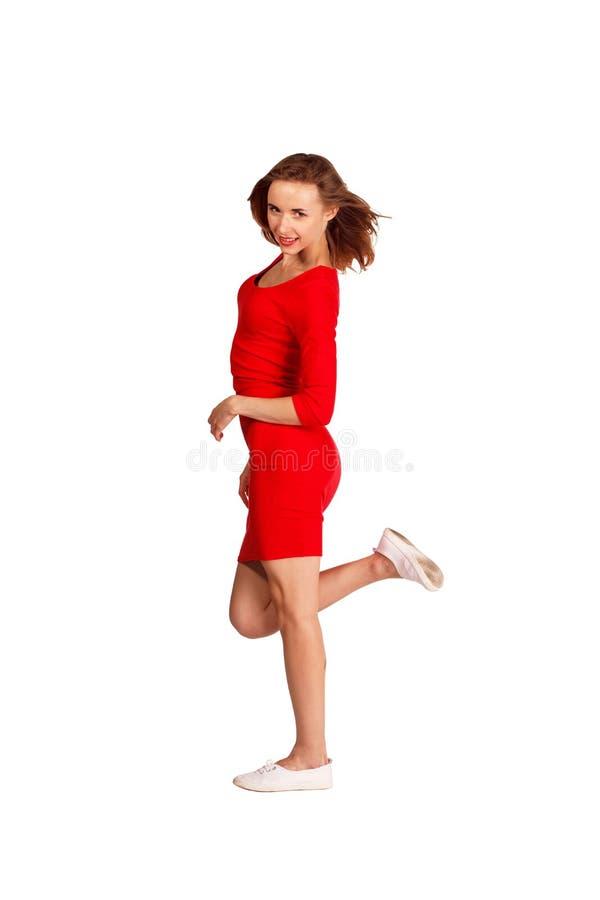 красный цвет девушки платья симпатичный стоковое изображение