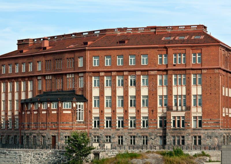 красный цвет здания кирпича хмурый стоковое изображение