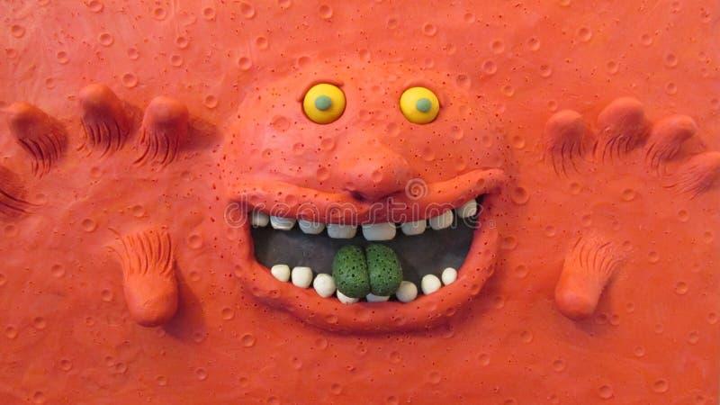 Красный цвет изверга пластилина глины стоковая фотография rf