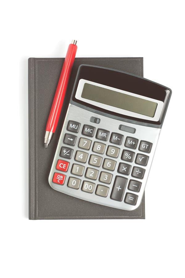 красный цвет карандаша дневника чалькулятора стоковые изображения