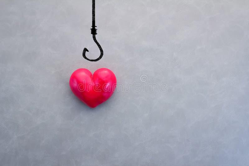 красный цвет крюка сердца рыболовства стоковые фото