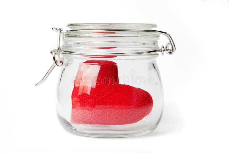 красный цвет опарника сердца стоковые фото