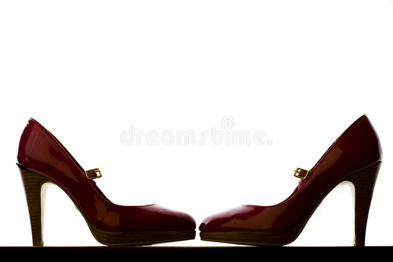 красный цвет пар backlit пяток высокий стоковое фото