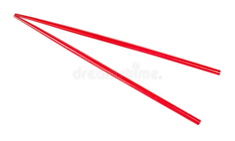 Красный цвет покрасил деревянные палочки изолированный стоковая фотография