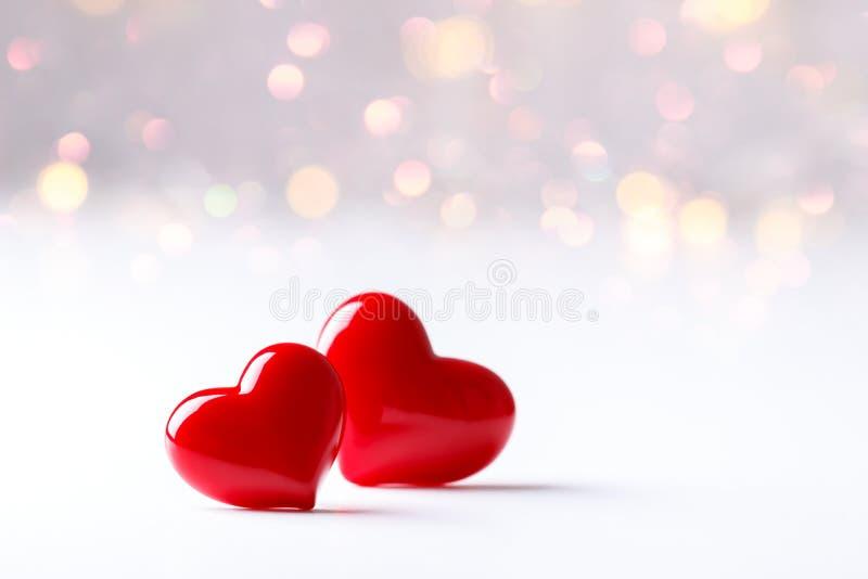 красный цвет 2 сердец стоковое фото