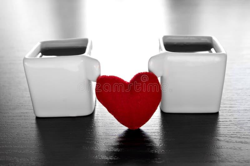 красный цвет сердца espresso стоковые фото