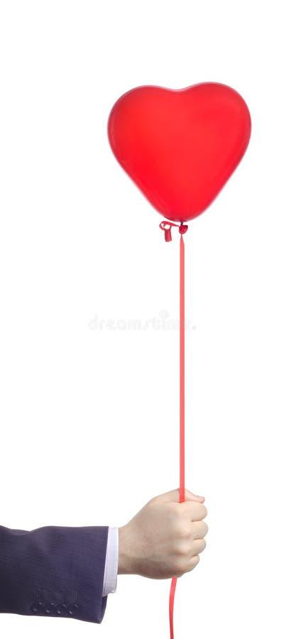 красный цвет удерживания руки воздушного шара стоковая фотография rf