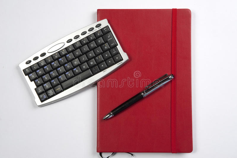 красный цвет чалькулятора книги стоковые изображения rf