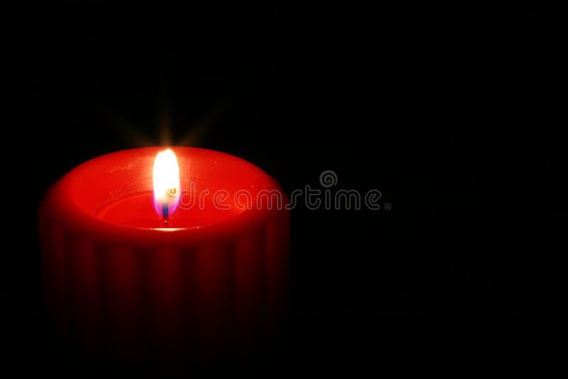 красный цвет 3 свечек стоковые изображения rf