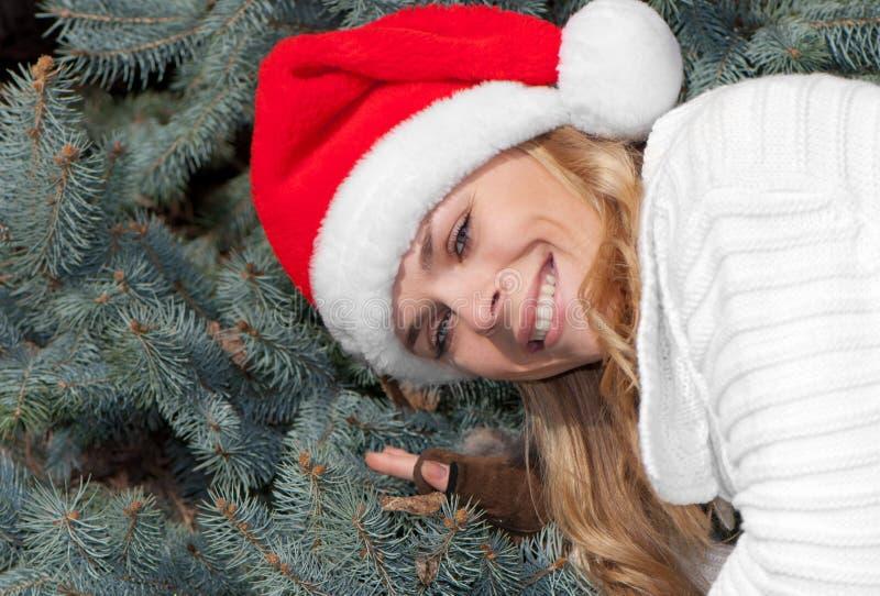 красный цвет santa девушки крышки красотки стоковое фото