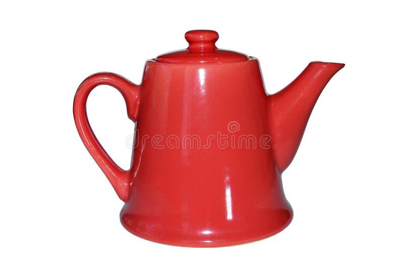 Красный чайник на белой предпосылке стоковые изображения rf