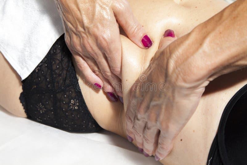 Красота и анти- массаж целлюлита стоковое фото rf