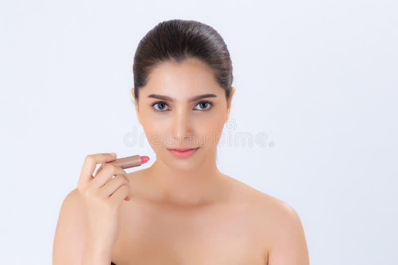 Красота применяться женщины портрета азиатский составляет с губной помадой рта изолированной на белой предпосылке стоковое изображение rf
