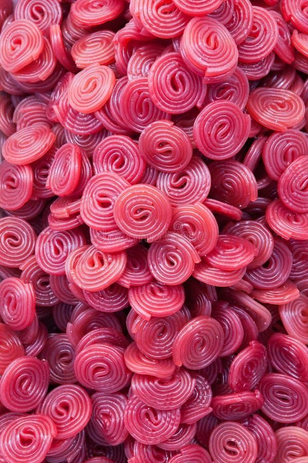 Красочная конфета катит красный пурпур стоковая фотография