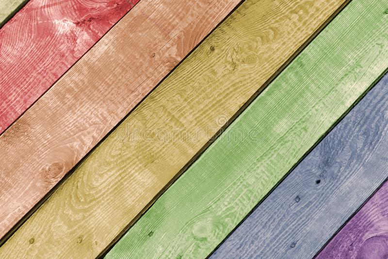 Красочная покрашенная деревянная предпосылка всходит на борт старой текстуры деревянной стоковое фото