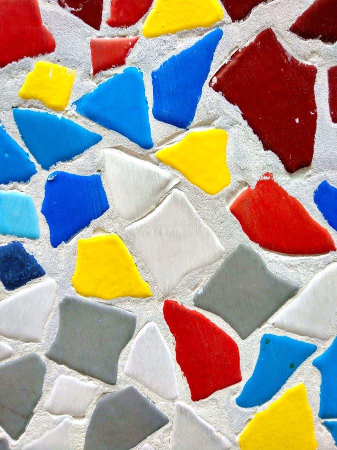 Красочная скачками геометрическая предпосылка текстуры каменной стены стоковые изображения