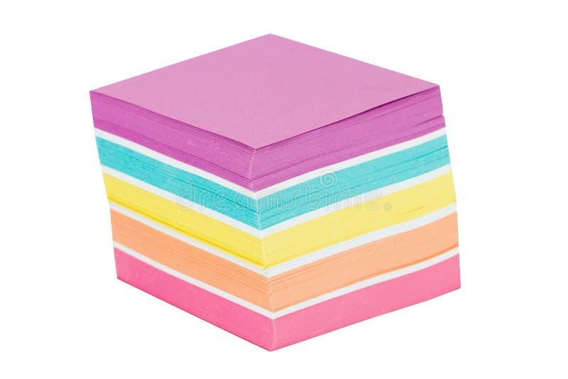 Красочное бумаги примечания изолированное на белой предпосылке конец вверх стоковое фото