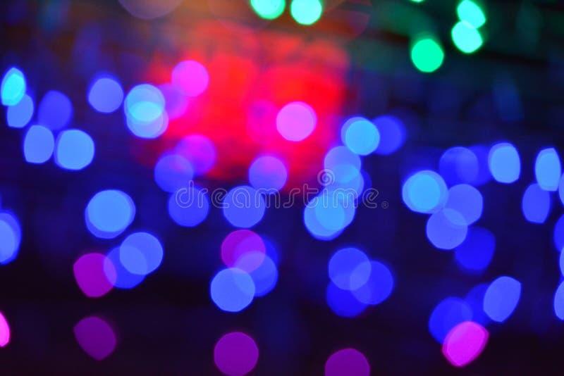 Красочное текстуры предпосылки ночи света Bokeh defocused стоковое фото