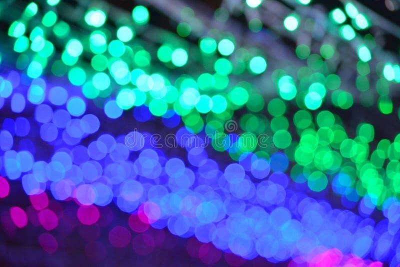 Красочное текстуры предпосылки ночи света Bokeh defocused стоковое изображение rf