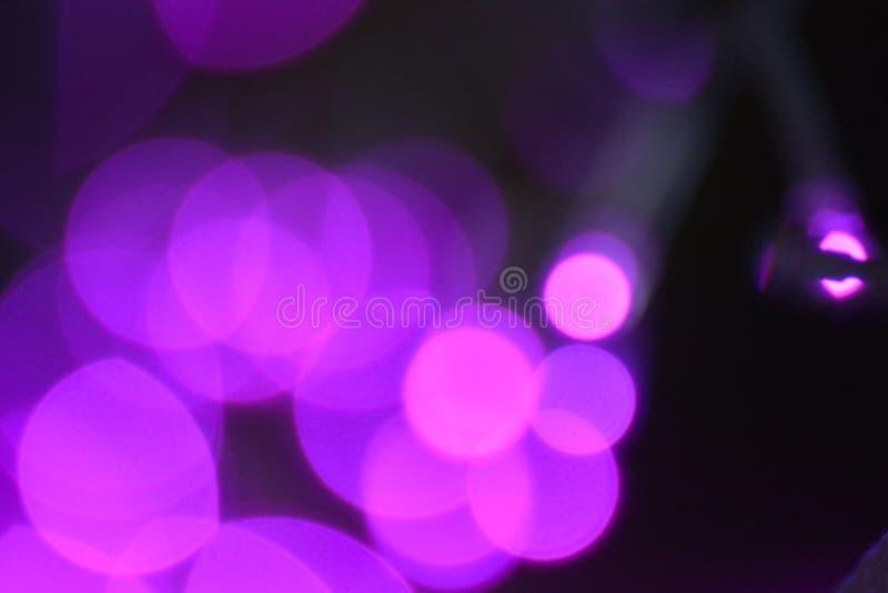 Красочное текстуры предпосылки ночи света Bokeh defocused стоковые фото