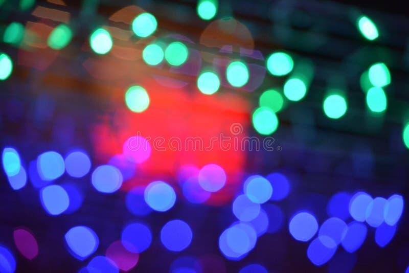 Красочное текстуры предпосылки ночи света Bokeh defocused стоковые фотографии rf