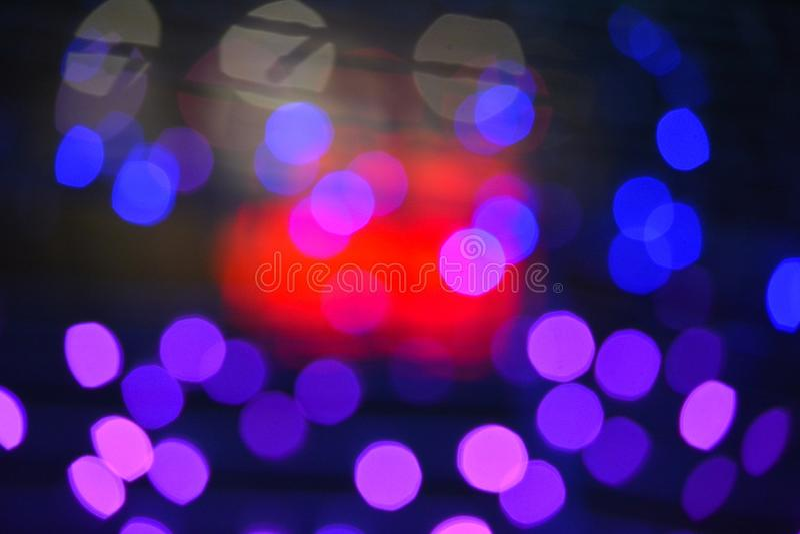 Красочное текстуры предпосылки ночи света Bokeh defocused стоковое фото rf