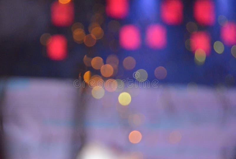 Красочное текстуры предпосылки ночи света Bokeh defocused стоковые изображения rf