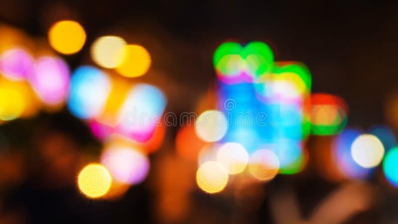 Красочное Bokeh объезжает для предпосылки, Defocused яркого блеска светлое стоковое изображение