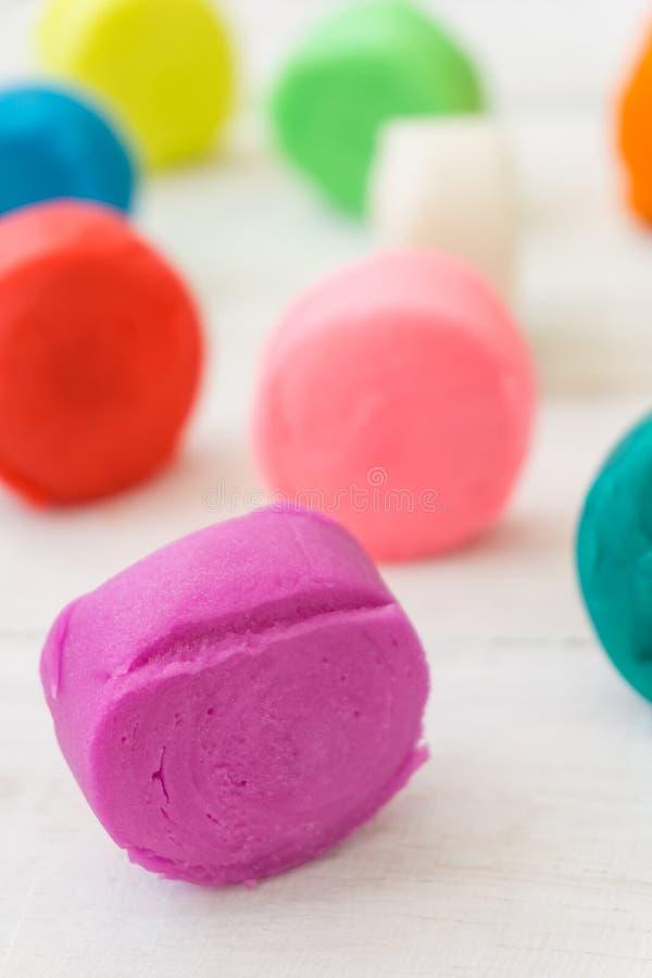 Красочное playdough на деревянном столе стоковое фото rf