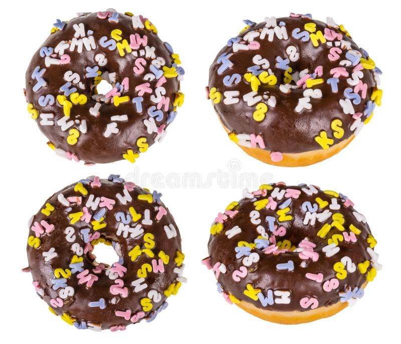 4 красочно украшенных donuts с замороженностью шоколада стоковые изображения rf