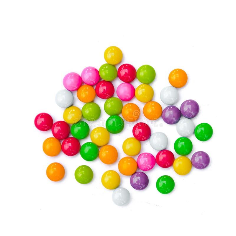 Красочные конфеты на предпосылке стоковые изображения