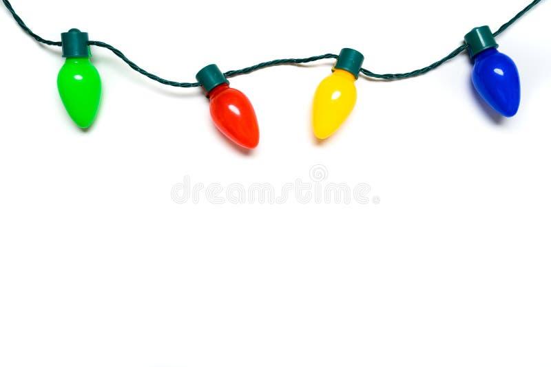 Красочные света рождества на белой предпосылке стоковое изображение rf