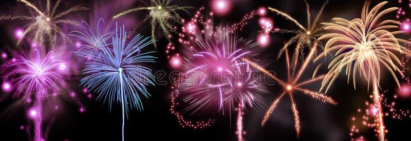 Красочный дисплей фейерверков в ночном небе стоковое изображение