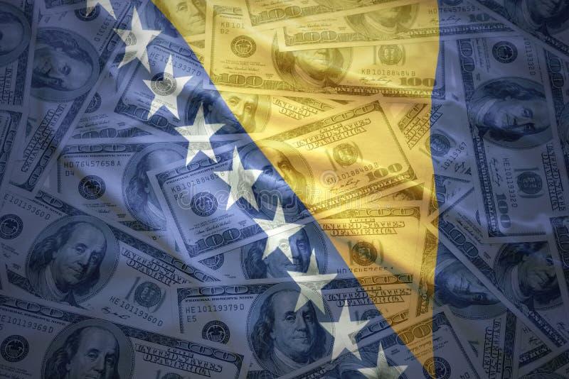 Красочный развевая боснийский флаг на предпосылке денег доллара стоковое изображение rf