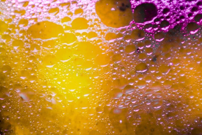 красочный свет и затенять красный оранжевый желтый цвет текстуры поверхности нерезкости масла стоковое изображение rf
